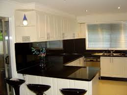 black glass backsplash kitchen white cabinets with black appliances smith design simple