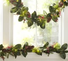 lit faux magnolia berry garland pottery barn