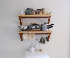 traditional wooden wall mounted kitchen spice shelves with three