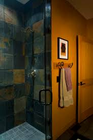 a gorgeous walk in shower with slate tile and gray floors if you