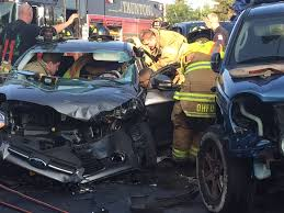 crashed jeep liberty firefighters pry off door to treat woman in crash near occ video