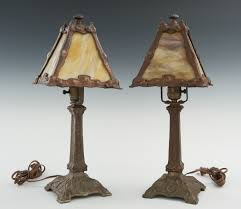 a pair of arts and crafts table lamps with slag glass shades