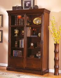 large bookcase with glass doors high dark brown wooden bookcase with four shelves and glass doors