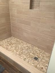 sliced java tan pebble tile shower floor 2 bathrooms pinterest