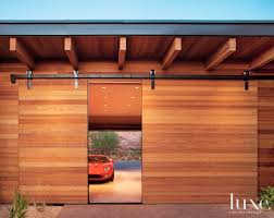 sliding barn style cedar door for an arizona garage doors
