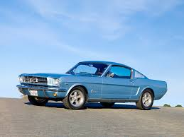 sky blue mustang 1965 mustang fastback silver blue 3 4 front view on road