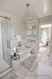 best ideas about small master bath pinterest diy master bathroom with pedestal tub chandelier and built ins goldenboysandme