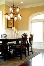 yellow dining room ideas designer kathy bush rescued a discarded chandelier from a client s
