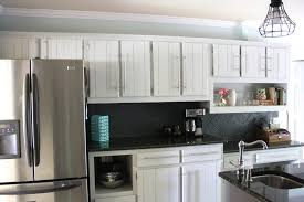 bedroom splendid black counter top beside silver fridge neutral