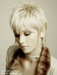 short hair with length at the nape of the neck pixie haircut with an elongated nape and sideburn tendrils