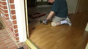Removing Laminate Flooring A Workman Or Homeowner Handyman Type Engaged In A Diy Project Of
