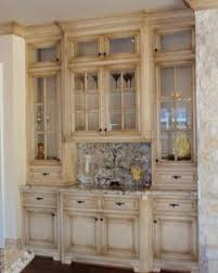 How To Distress Kitchen Cabinets by Like The Small Paned Glass Cabinets Also Drawers Under Cabinets
