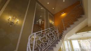 luxury livingrooms panorama hall with a staircase in fashion house view showcase of