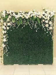 wedding backdrop grass step and repeat for a corporate event boxwood flower wall glamor