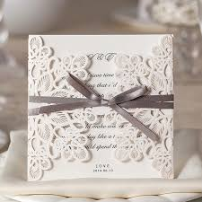 ribbon cheap ivory laser cut cheap wedding invitation with ribbon wlc015