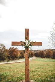 the smarter way to wed wooden crosses leaves and fabrics