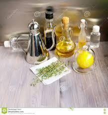 various ingredients for salad dressing oil olive oil vinegar