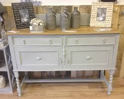 this sideboard has been hand painted in after rain autentico