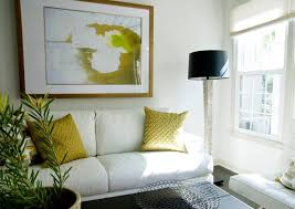 home staging interior design white leather sofa green accent