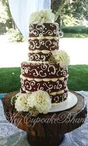 red velvet semi dressed wedding cake dahlias rustic country