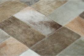 Hair On Hide Rug Beige And White Patchwork Cowhide Rug Bricks Designed By Shine