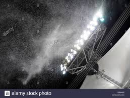 mercedes benz arena stuttgart snow falling at a light mast of the mercedes benz arena stuttgart