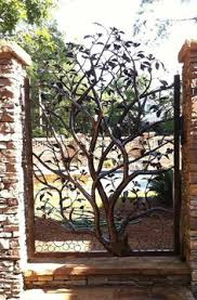 i this iron tree design in the rustic wooden garden gate