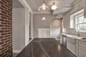 kitchen cabinet downlights oak wood kitchen cabinet brown leather sofa grey floor tile modern