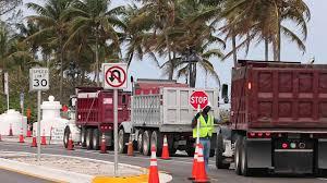 dump trucks supply sand for largest truck haul beach renourishment