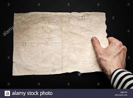 Blank Pirate Map Template by Strong Sailor Hand Holds Empty Old Crumpled Paper Sheet Over Black