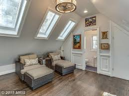 traditional attic with cathedral ceiling u0026 hardwood floors in