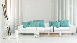 canap entr e canapé blanc large décoré par couleur turquoise oreillers entre les