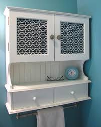 White Bathroom Cabinet With Glass Doors Add A Towel Bar Bath Cabinet Bathroom Ideas Pinterest