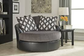 amazon com ashley kumasi oversized swivel accent faux leather