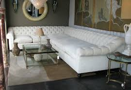 themed coffee table white leather oversized sectional sofa with tufted back and rolled