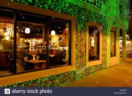 starbucks coffee shop with christmas lights during the big bright