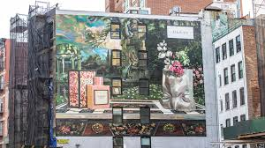 gucci celebrates their fragrance bloom with new art wall the spanish artist showed the beauty and singularity of an almost forgotten art form hand painted outdoor advertising he illustrated his vision of the