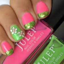 pink and green nails with accent rhinestones flower nail art