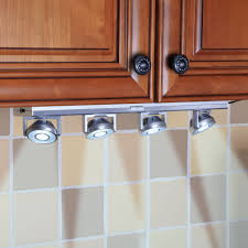 Led Lights Under Kitchen Cabinets by The Under Cabinet Pivoting Spotlights Hammacher Schlemmer