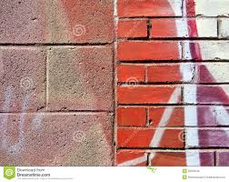 cinder block and brick wall with graffiti royalty free stock image