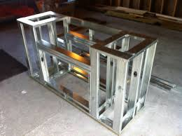 built in smoker outdoor kitchen car jacks and a steel drum with