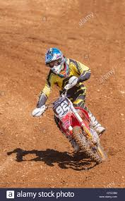 motocross bike a motocross bike scrambler riding in the mud in the uk stock photo