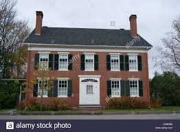 colonial revival style home full length view of a brick colonial revival style house in