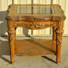 carved wood end table schnadig roman inspired carved wood end table ebth