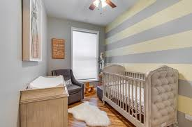 yellow stripe nursery transitional with tufted crib wooden baby