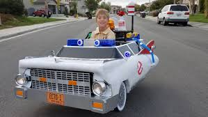 halloween costumes for dad and son dad turns son u0027s wheelchair into awesome ghostbusters car today com