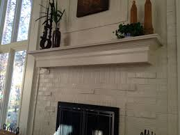 cozy brick fireplace mantel on interior with brick and modern