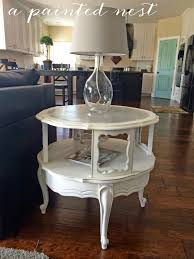 a painted nest round traditional end table