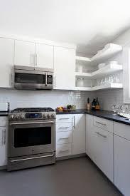 floating shelves black granite countertops modern kitchen