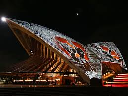sydney opera house lit up with aboriginal australian art